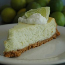 Key Lime Cheesecake II Recipe - Key lime cheesecake - sweet, tart and delicious! You may add 1 drop of green food coloring if desired. Garnish with whipped cream.