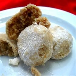 Sandies Recipe - Simple molded pecan sugar cookies rolled in confectioners' sugar.