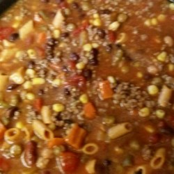 Quick Texas Stew Recipe - Browned ground beef is combined with cans of corn, minestrone soup, ranch-style beans and chopped tomatoes with chilies to create this Tex-Mex meal in a bowl.