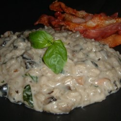 Creamy Mushroom Risotto Recipe - Cream of mushroom soup lends this porcini mushroom risotto a creamy taste without actually using heavy cream. If you like, stir in freshly grated parmesan cheese before serving.