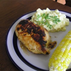 Chipotle-Citrus Marinated Chicken Recipe - A spicy citrus marinade - orange juice, lime juice, cilantro, and chipotle powder - gives a Cuban taste to these grilled chicken breasts.