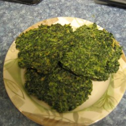 Spinach Pancakes Recipe - Simple spices, eggs, flour, and spinach are used to make these spinach cakes pan-fried in a small amount of olive oil until crisped and browned. These make a quick and tasty side dish, and are a great way to add veggies to your meals.