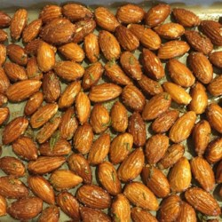 Anytime Almonds Recipe - These almonds are coated with garlic, rosemary, kosher salt, and olive oil and baked to a savory finish. Delicious warm or cool, they pair well with Kalamata olives and feta cheese on an appetizer tray.