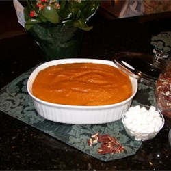 Sweet Potato Pudding Recipe - Cooked, mashed sweet potatoes are combined with butter, brown and white sugar, eggs and orange juice in this easy baked pudding. Great side dish for your Thanksgiving feast!