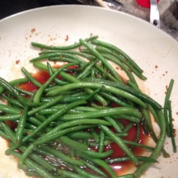 Honey Ginger Green Beans Recipe - Fresh green beans simmer in honey and soy sauce, fragrant with fresh garlic and ginger, in this easy side dish.