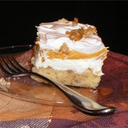 Pumpkin Cheesecake I Recipe - The cheesecake layer in this delicious pie is spread over a fabulous baked pecan crumble crust. The pumpkin layer, made from pumpkin puree, vanilla pudding, and whipped topping, is spooned over the cream cheese and topped with more whipped topping and chopped nuts.
