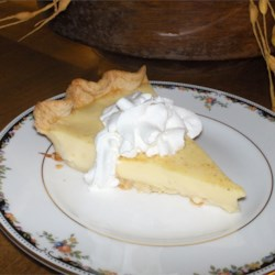 Grandma's Egg Custard Pie Recipe - Once you taste this pie you'll know why this is a blue ribbon winner. The custard is sweet and creamy and bakes up perfectly. The crust stays flaky and delicious. Garnish with freshly grated nutmeg.