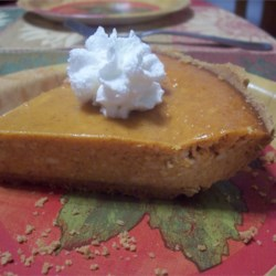Pumpkin Cheese Pie Recipe - Only five ingredients are needed for the filling of this tasty cheesecake-like pumpkin pie.