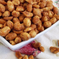 Chipotle Honey Roasted Peanuts Recipe - Peanuts are tossed with chili powder, garlic powder, and chipotle chile powder, then coated in a honey-butter glaze and baked until golden brown.