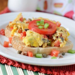 Eggs Creole Over Toast Recipe - Enjoy this easy Creole egg scramble loaded with tomatoes, mushrooms, and peppers for a quick and delicious breakfast.