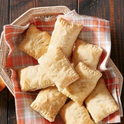 Country Ham and Cheddar Mini Hand Pies Recipe - These tiny appetizers-packed with country loving in every bite-are straight from the kitchen of Amber Wilson of For the Love of the South.