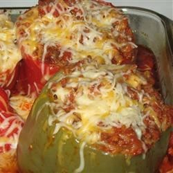 Chorizo Stuffed Bell Peppers Recipe - Bell peppers are stuffed with a spicy blend of chorizo, onions, garlic, fresh herbs, Worcestershire, three kinds of cheese, and rice. If you have a taste for spice, you'll love them.
