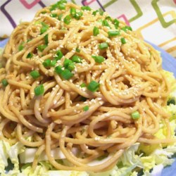 My Favorite Sesame Noodles Recipe - Spaghetti noodles are tossed with peanut butter, tamari, and Thai chili sauce for this quick, Asian-inspired meal for one.