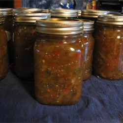 Suzy's Green Tomato Relish Recipe - That patch of green tomatoes can yield a dozen pints of sweet and tangy green tomato relish with this old time recipe.