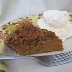 Walnut Pumpkin Pie Recipe - A slight twist on the traditional pumpkin pie. Originally submitted to ThanksgivingRecipe.com.