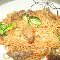 Spicy Beef and Broccoli Chow Mein Recipe - Spicy beef and broccoli chow mein with plenty of vegetables and flavor is an easy meal to whip up for weeknight meals.