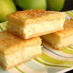 Cream Cheese Squares Recipe - Refrigerated crescent roll dough is layered with cream cheese and cinnamon sugar to make a quick and tasty treat.