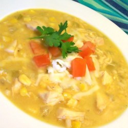 Mexican Chicken Corn Chowder Recipe - This creamy chicken and corn chowder, made spicy with ground cumin, green chilies, and hot pepper sauce, will warm you right through.  Shredded Monterey jack cheese and half and half make this soup rich and delicious.