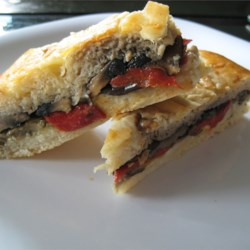 Grilled Mediterranean Vegetable Sandwich Recipe - This is a delicious recipe for a focaccia sandwich with roasted eggplant and red bell peppers and sauteed portobella mushrooms.  You can substitute your favorite veggies and use any Italian flat bread you choose.