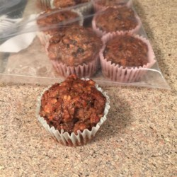 Vegan Date, Walnut, and Zucchini Muffins Recipe - These date, walnut, and zucchini muffins are made vegan with the help of chia seeds and applesauce in the batter.