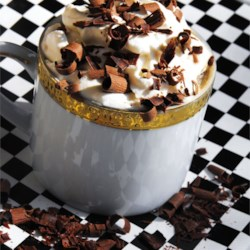 Cafe Latte Milkshake Recipe - A delightful coffee milkshake to pick you up on those hot days. If you feel like going to extreme measures, top it with a dollop of whipped cream and chocolate shavings.