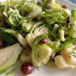 Hazelnut and Fresh Brussels Sprout Salad Recipe - Shredded Brussels sprouts salad with hazelnuts and blue cheese tossed in a citrus dressing is a refreshing way to prepare Brussels sprouts.