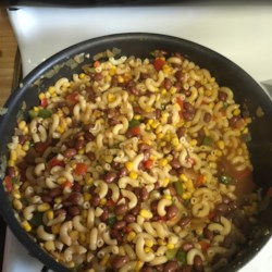 Pecos Pasta Recipe - A sweet saute of bell peppers and onions is stirred into canned chili with beans and canned corn to make a quick and hearty sauce for cooked macaroni. Try grating Cheddar cheese and sprinkling olive slices over the top.