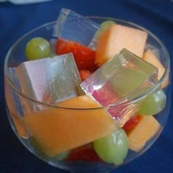Almond Ice Recipe - This is a very light almond gelatin that chills and sets up beautifully. Chill in a large pan so that it can be cut into squares and tumbled into serving dishes and topped with fresh fruit.