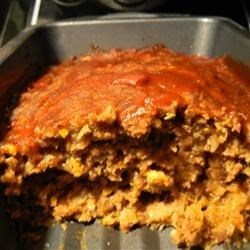 Kitchen Sink Meatloaf Recipe - A slightly sweet, melt-in-your-mouth meatloaf with a variety of always-on-hand ingredients. It's super easy to make and a real crowd-pleaser. This recipe is always requested at family functions and parties.