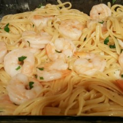 Linguine with Scampi Recipe - A nice hot oven does the work for you in this snappy version of pasta with shrimp. Butter, lemon juice, garlic and shrimp go for a five-minute bake with a nice sprinkling of parsley. Toss with hot linguini and you're ready to eat!