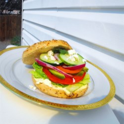 Fresh Veggie Bagel Sandwich Recipe - This sandwich is so healthy and fresh! Crispy veggies and tangy mustard make this meal a real treat that you won't have to feel bad about eating. This sandwich is terrific with gourmet kettle cooked potato chips!