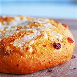 Sun Dried Tomato Focaccia Recipe - You will give thanks for your bread machine when you make this chewy, rosemary- and garlic-seasoned focaccia that features sun-dried tomatoes, Parmesan and mozzarella.