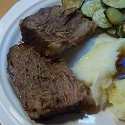 Rump Roast Au Jus Recipe - This spice-rubbed roast is done in a slow cooker for 8 to 10 hours. The pot liquids are skimmed and strained before serving.