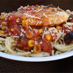 Spicy Chicken Spaghetti Recipe - A chunky and very spicy sauce with chicken makes a nice hearty topping for angel hair pasta.