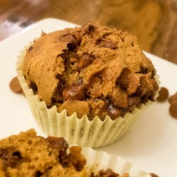Easy Pumpkin Spice Muffins Recipe - These rich, moist, and spiced muffins require only a box of spice cake mix, a can of pumpkin puree, and cinnamon chips.
