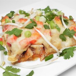 Thai-Italian Fusion - Sweet Chile Chicken Pizza Recipe - Pizza made with sweet Thai chile sauce topped with bamboo shoots and green onion and cilantro is a delicious fusion of Italian and Thai flavors.