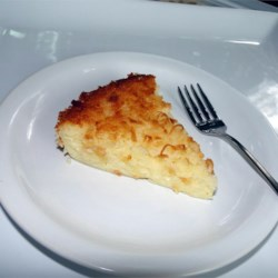 Impossible Coconut Pie I Recipe - We like this pie because the filling makes its own crust. All the ingredients are mixed in an electric blender, poured into a pie plate, sprinkled with coconut, and baked up into a rich custardy pie.
