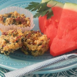 Savory Quinoa Muffins (Gluten-Free) Recipe - Savory gluten-free muffins, loaded with bacon, spinach, and cheese, are a portable breakfast item perfect for on-the-go eating.