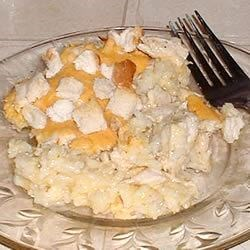 Cheesy Chicken and Rice Casserole Recipe - You can do all the prep work the night before, combining the chopped chicken with rice, cheddar and cream of chicken soup right in the baking pan.  Top with soft bread cubes just before you pop it in the oven.