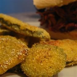 Fried Pickles Recipe - Dill pickle slices become crispy, golden appetizers when marinated in buttermilk, dressed with a corn meal/flour coating, then deep fried. Old Bay and Cajun seasonings add a kick to their crunch and a buttermilk-ranch dipping sauce.
