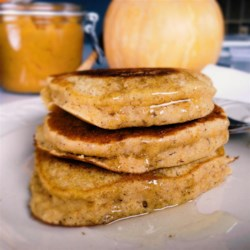 Pumpkin Cornmeal Pancakes Recipe - Pumpkin cornmeal pancakes make for the perfect fall breakfast with some pecans and real maple syrup over the top.