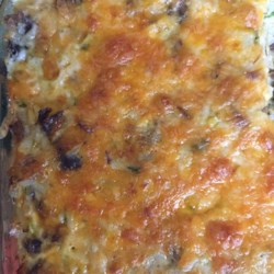 Cheesy Turkey Rice Casserole Recipe - Use your leftover cooked turkey to make a creamy, cheesy casserole with a mild Mexican flavor.