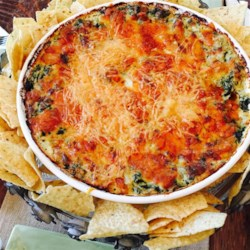 Fabulous Spinach and Artichoke Dip Recipe - Replicate a popular restaurant appetizer for a cheesy spinach and artichoke dip with this recipe.