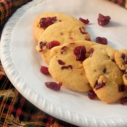 Cornmeal Cookies IV Recipe - Cornmeal cookies that are not only buttery and sugary, but quite spicy! They also have cranberries and orange juice!
