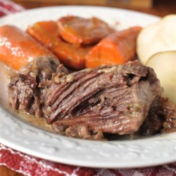 Pot Roast Recipe - Pot roast and vegetables are baked at a low temperature for 3 hours and then topped with a homemade gravy made with pan juices.