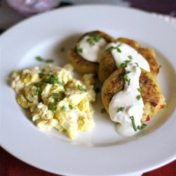Spaghetti Squash Hash Browns Recipe - This dish substitutes versatile spaghetti squash for potatoes in a side dish that looks like potato patties. They're served with a dollop of sour cream.