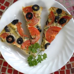 Vegetable Pizza Frittata Recipe - Eggs, Parmesan cheese, tomatoes, and olives are cooked together in this pizza frittata creating an Italian-inspired healthy dinner or brunch.