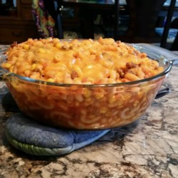 Sissy Casserole Recipe - This casserole of ground beef, seashell pasta, and corn in a tomato sauce is started on the stove top and finished in the oven.