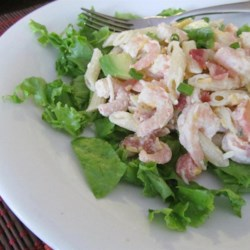 Shrimp Avocado Pasta Salad Recipe - Avocados and shrimp are tossed with bacon, cheese, and tomatoes in this super pasta salad. Great as a side dish, but also works as a cool summer entree.