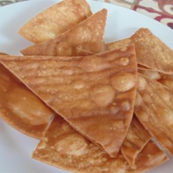 Fried Flour Tortilla Chips Recipe - Fried flour tortilla chips are quick and easy to prepare and only require 2 simple ingredients, creating a crunchy snack chip.